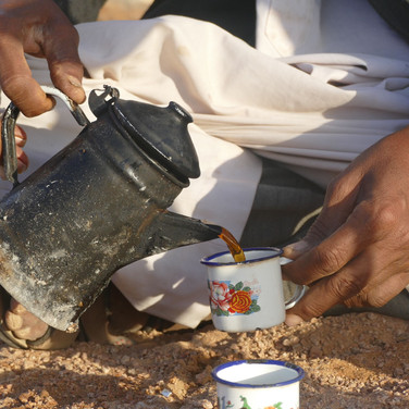 Whenever a Bedouin family is met on the way hikers will be invited to share tea & it can be virtually impossible to leave until their offer is accepted. Hospitality is taken seriously in the desert. As a minimum a Bedouin host will prepare a pot of tea or coffee & will usually offer much more, compelling guests to stay longer & eat together. Bedouin tea is drunk black & sweet with sugar usually measured in by the handful, although increasing numbers of Bedouin are cutting down on sugar in modern times.
