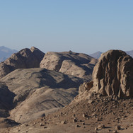 The trail follows an intricate route over Jebel Gattar through huge, crumpled slabs of granite.