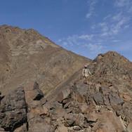 Mohammed descending the narrow lower parts of Jebel Um Samyook's summit ridge.