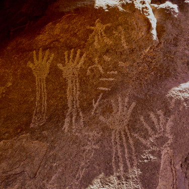 Ancient graffiti is found etched on the rocks too, including these hand markings. What else can you see apart from the hands?