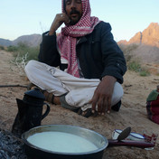 Maaza tribesman Salama Abu Salah heats fresh goat milk by the fire. He is the head of this family & has lived in the desert his whole life. A century ago most of the tribe would have lived this way but today most Bedouin have abandoned the nomadic life and settled in nearby towns and villages. People like Salama are some of the last Bedouin in Egypt to keep this old way of life alive.