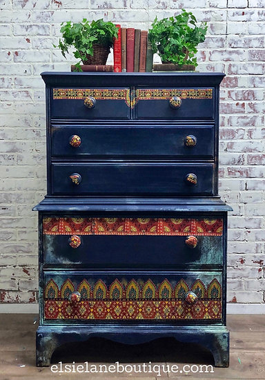 Six drawer Bohemian style tall dresser painted dark blue with red border and cop