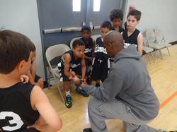 Coach Chad w. Team During Timeout