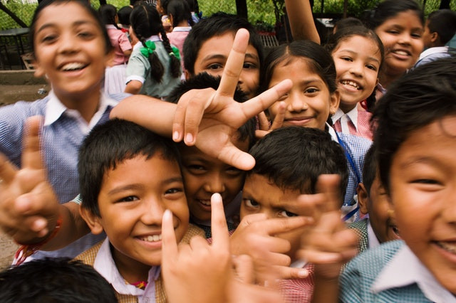 A group of Asian schoolchildren smiling at the camera