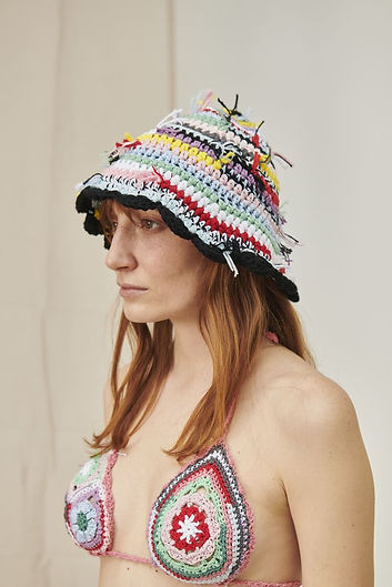 model wearing crochet hat and bikini top fromcult label Cavia