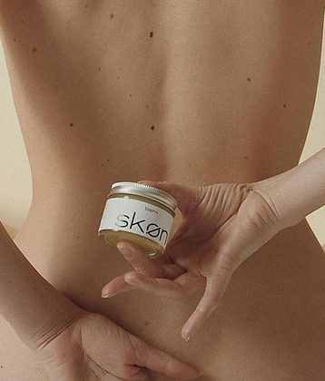 Skon clean beauty product in front of bare skin back