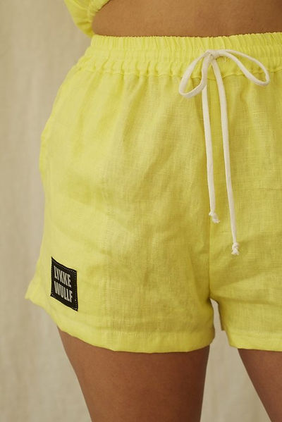 Lykke Wolf - yellow deadstock linen shorts surf