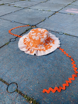orange sunhat made with upcycled towels from picnic wear