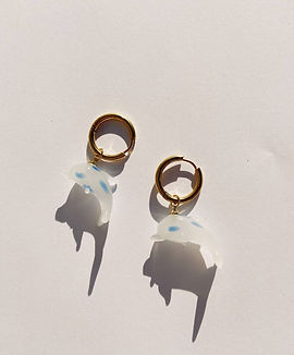 glass dolphin charms on golden hoops from sustainable jewellery brand Ninfa Handmade
