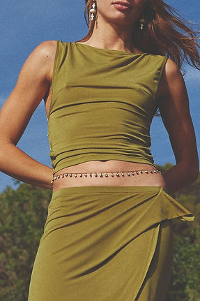 Amlul model wearing moss green 90s style skirt and belly chain