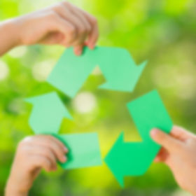 Paper RECYCLE sign in children`s hands a