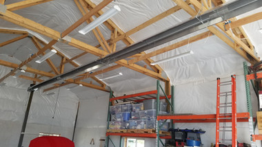Infrared tube heater in a detached residential garage and workshop