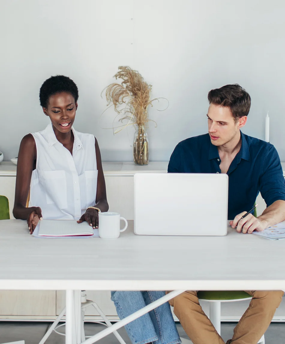 Photo of designer and developer working together