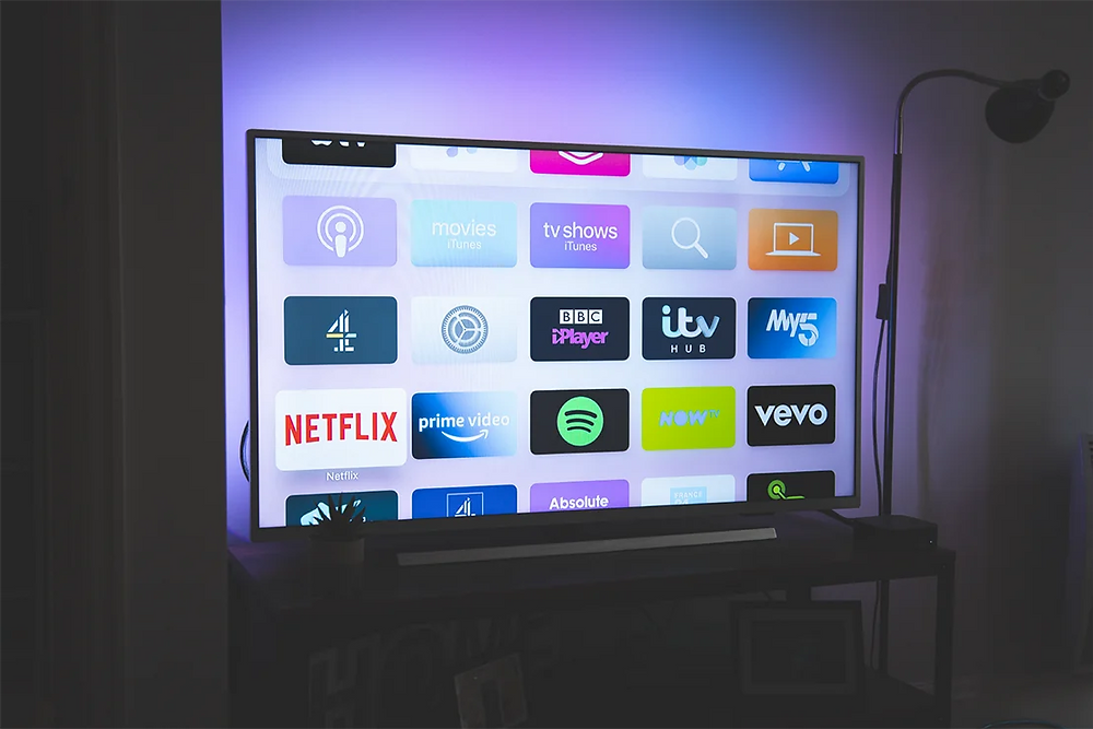A large television screen with different apps.