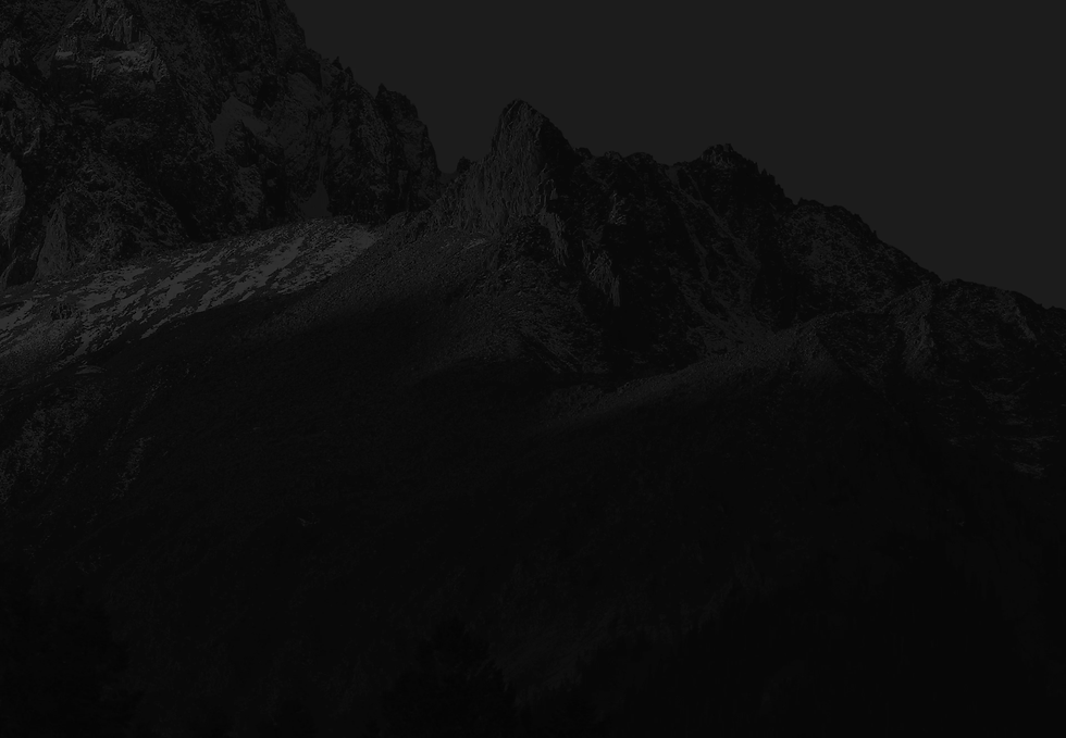 Black background image with shadowy mountain ranges.