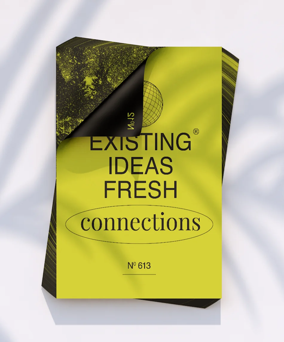A pile of posters that read: Existing ideas fresh connections.