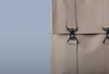 Beige leather backpack on grey background