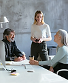 Photo of three people talking in an office