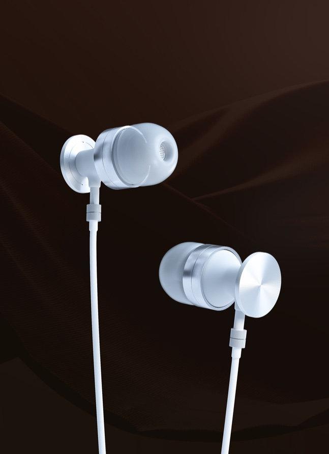 White earphones on a dark backdrop