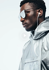 Video thumbnail of a guy wearing an anorak, headphones and sunglasses.