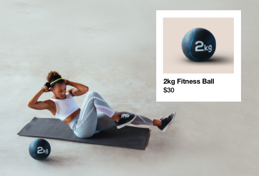 woman exercising on a mat with an exercise ball sold by a gym on Wix with dropshipping