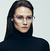 Image of a dark haired woman wearing stylish glasses in the left grid cell