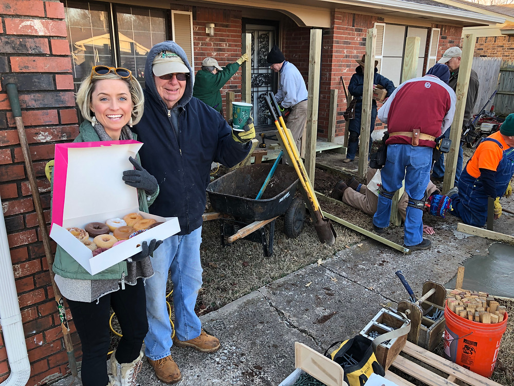 Image of women with box of donuts for Rebuilding Together volunteers