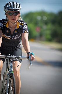 Becky Cavnar Marketing Account Coordinator riding a bike