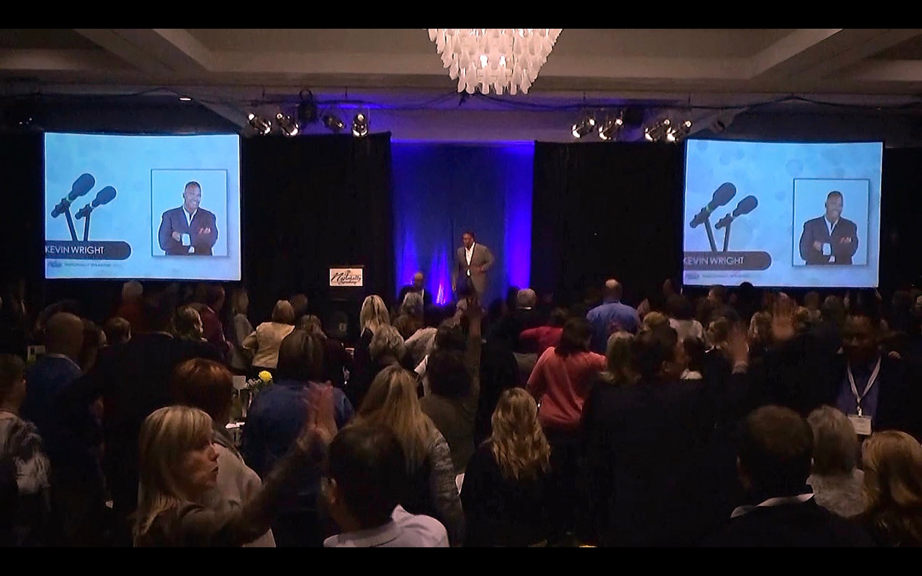 Keynote Speaker Kevin D Wright motivates a business crowd in Walsall England for Homeserv UK