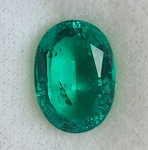 Colombian color created Emerald with incusions 14x10 oval