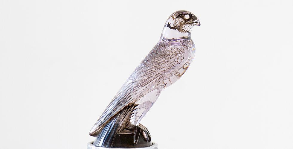A Rare Mauve tinted Glass Falcon Car Mascot by René Lalique, circa 1925