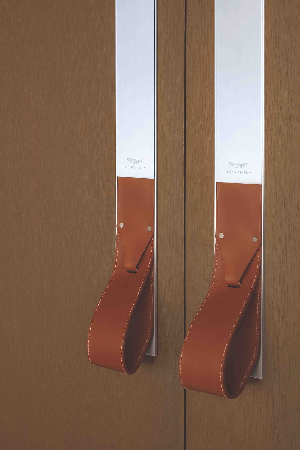 Signature Balmoral Leather Accents on Doorways at Aston Martin Residence