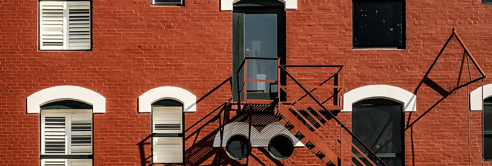 Old red brick building and fire escape - long deep shadows