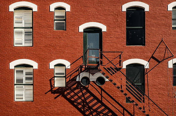 Old red brick building and fire escape M