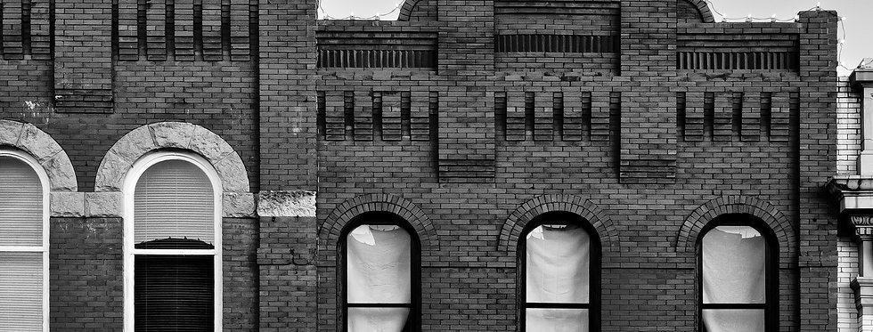Black and White image of store fronts from McKinney square  - McKinney Texas