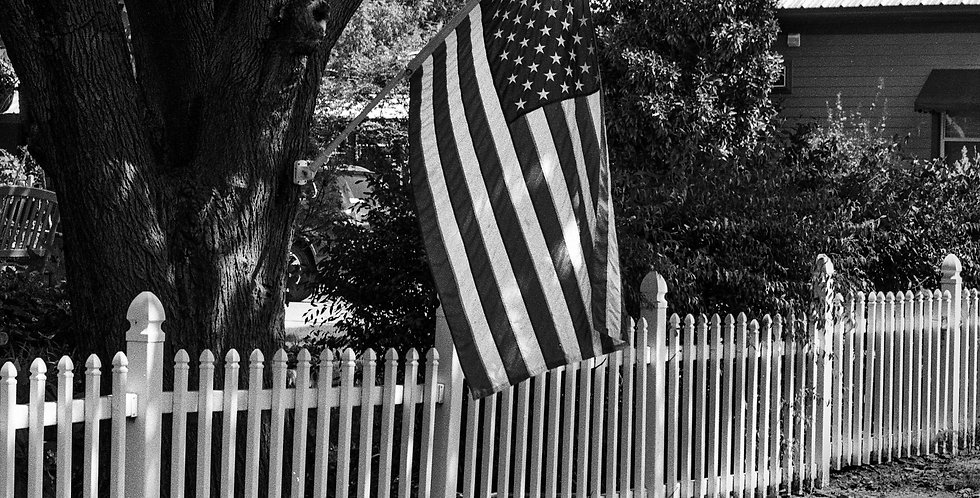 Old Glory and white picket fence - Frisco Texas