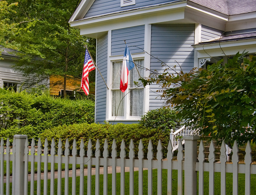 Small Town Life - picket fence, American and Texas flag