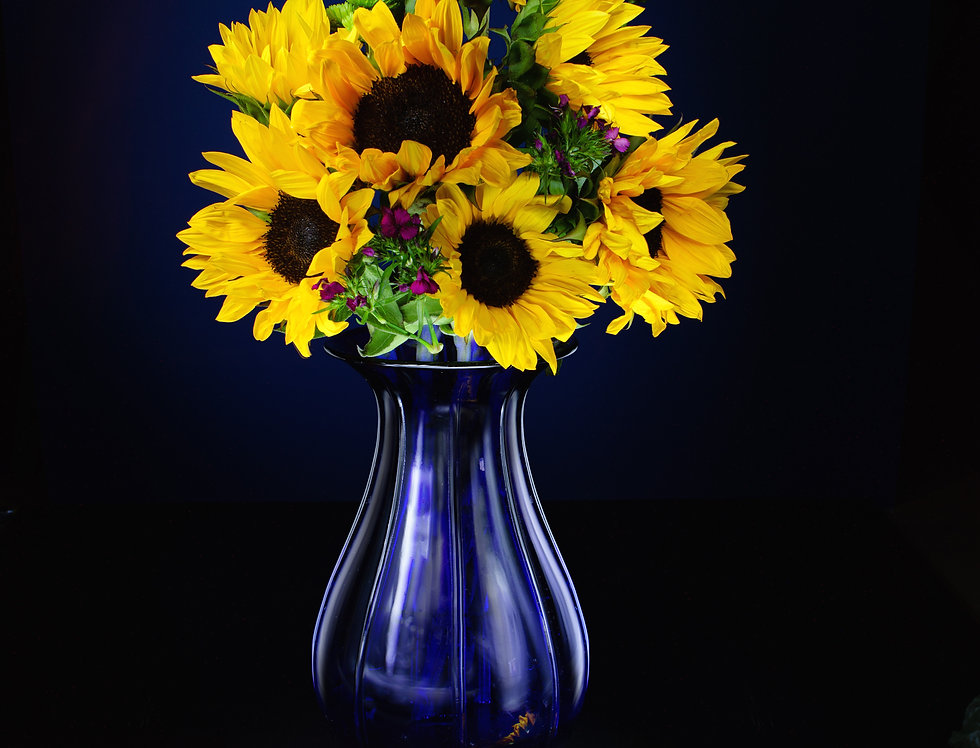 Yellow sunflower and a blue vase