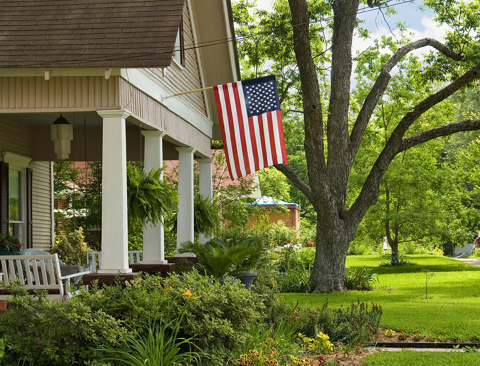 American flag  hanging above the front porch