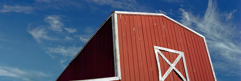 Red Barn with blue sky and cloud swirls