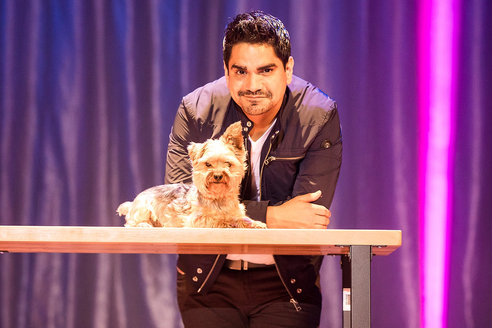 Illusionist Jason Bishop poses with one of his assistants, a Yorkie named Gizmo.