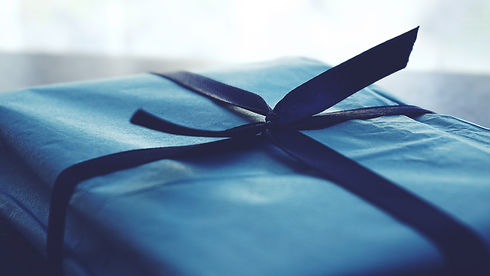 close-up-photo-of-tied-blue-box-1178562.
