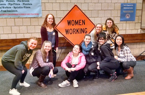 Boston Local 103 hosted a first-of-its-kind conference to encourage girls to enter the trades. Among the attendees were students from Minuteman High School: Lola Clemente, left, Erica Grandon, Aibhlinn Moore, Lindsey Kelly, Haley Rice, Hannah English, Midalia Ramos, Kendra Hennigan and Kaylah Bennett. Photo credit: Neeva Coovert, Minuteman student photographer