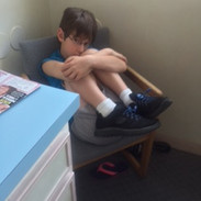 Alex when he was six years old. He used to sit like this constantly, due to pain.
