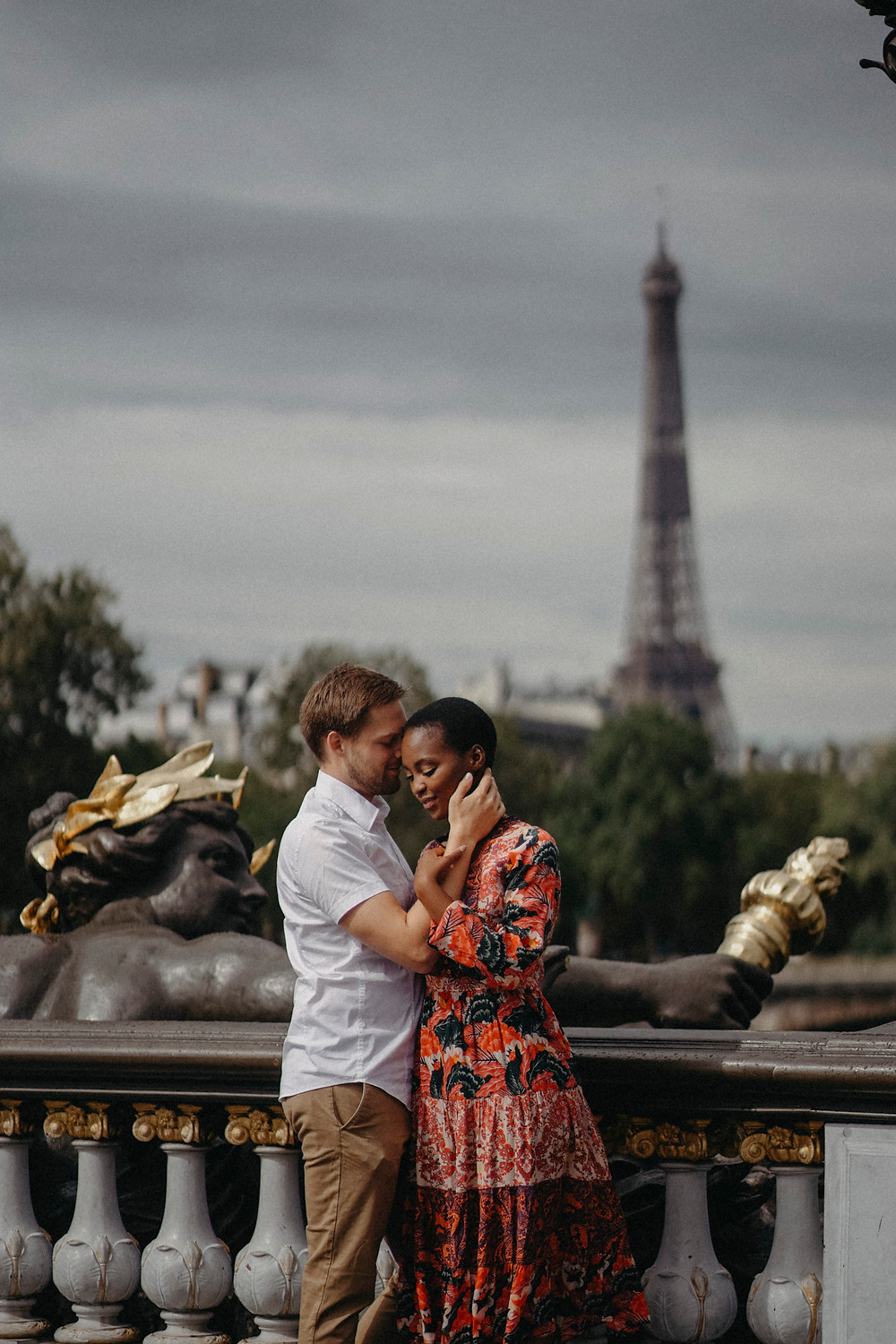 Interracial Couple intimate with eiffel tower in the background
