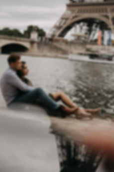 paris-engagement-couple-sit-on-the-Seine