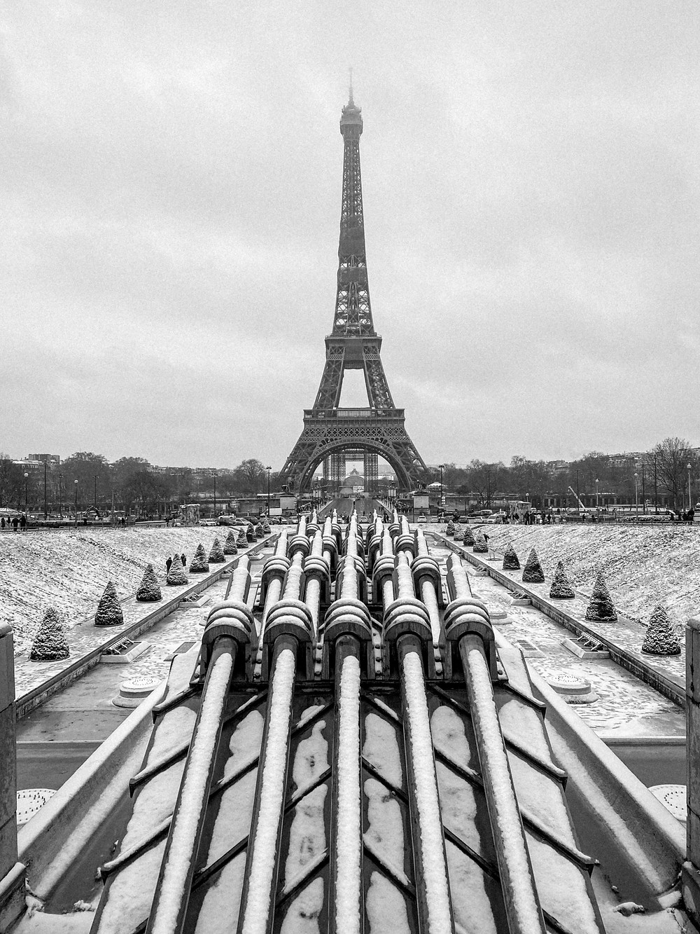 snow in paris eiffel tower black and white photo