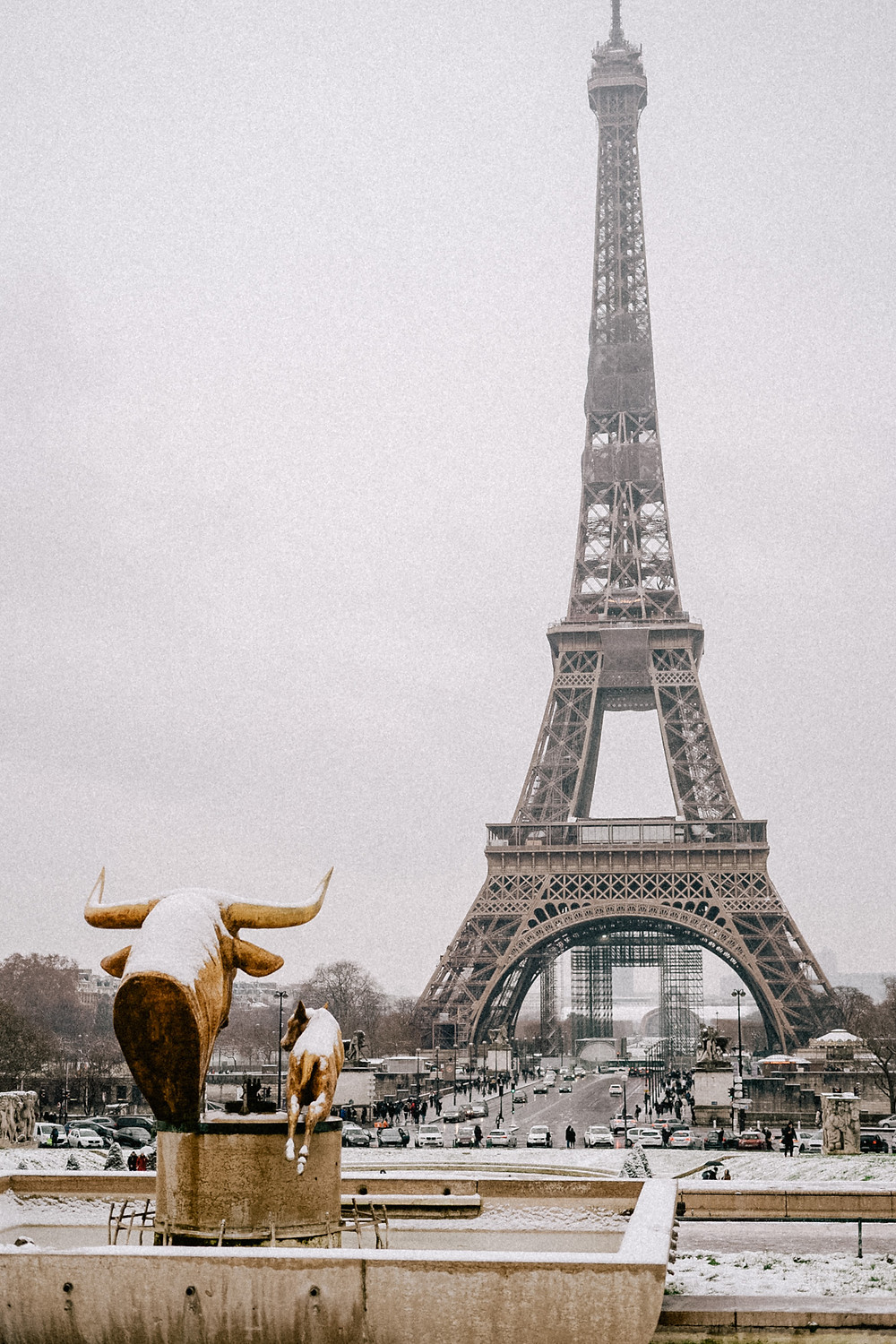snow at eiffel tower paris