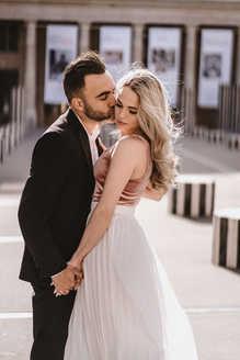 paris-photo-shoot-Couple-kiss-on-the-cheeks at Palais Royal