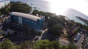 "The research station, known as the Caribbean Marine Biological Institute (CARMABI) was soon established at the open end of the bay to conduct research in the field of ecology—fisheries in particular. Renamed Caribbean Research and Management of Biodiversity Foundation after a merger with National Parks Foundation of the Netherlands Antilles (STINAPA), but still referred to as CARMABI, or CARMABI Foundation, it is ""the largest field station in the Southern Caribbean""."